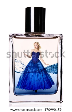 Fashion model in a long luxurious dress inside a perfume flask - stock photo