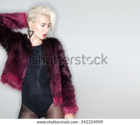 Fashion model in colorful coat with short hair - stock photo