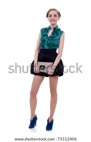 fashion model in fashion dress posing holding little purse on white background - stock photo