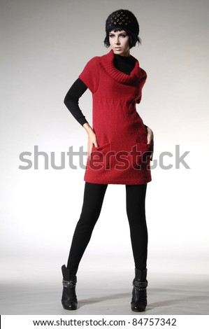fashion model in fashion dress posing in light background - stock photo