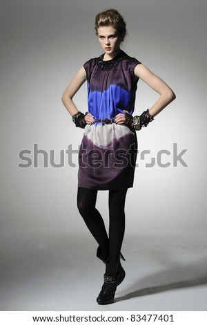 fashion model in fashion dress posing in the studio - stock photo