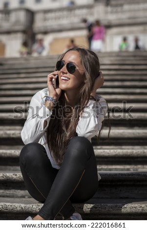 Fashion model in hispanic stairs. Rome, Italy