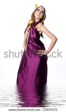 Fashion Model in Professional Hair and Makeup; Girl as beauty nymph with Tulips in water - stock photo