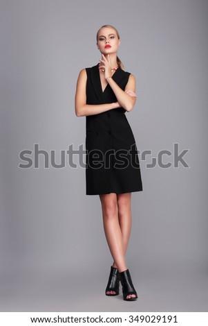 Fashion model in simply black dress. - stock photo