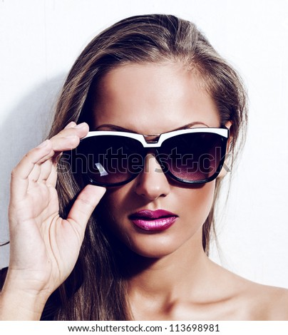 fashion model in sunglasses , beautiful young woman - stock photo