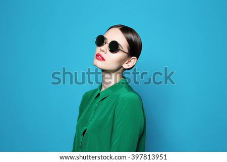 fashion model in sunglasses , beautiful young woman. Studio shot - stock photo