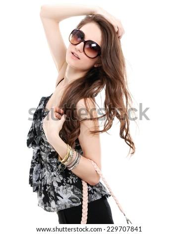 fashion Model in sunglasses holding bag walking posing  - stock photo