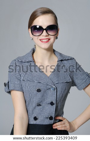 fashion model in sunglasses posing gray background - stock photo