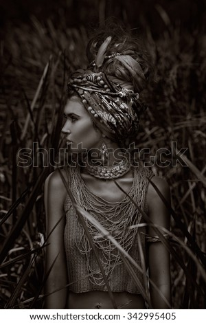 fashion model in turban. black and white portrait - stock photo