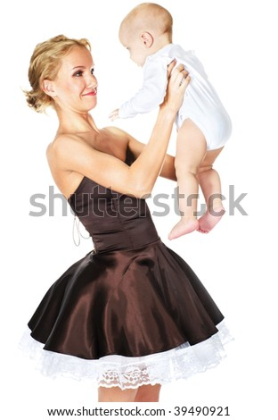 fashion model looking at baby with suprise - stock photo