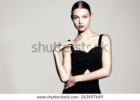 fashion model portrait. beautiful young woman on grey background - stock photo