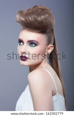 Fashion Model Portrait. Hairstyle. Haircut. Professional Makeup. Creative makeup. Closeup portrait. Studio shot. - stock photo