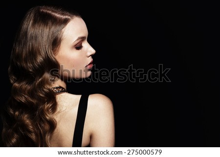 Fashion model portrait.Pretty young woman. Side view face - stock photo