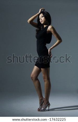 Fashion model Posed on light background in nice dress