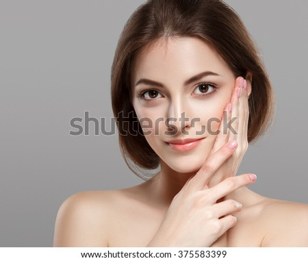 Fashion model posing at studio close-up face beautiful  - stock photo