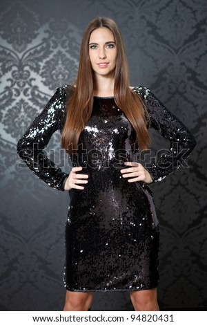 Fashion model posing in black sequin dress - stock photo