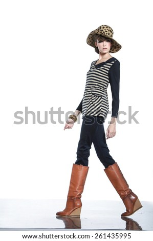 fashion model posing in hat walking on hat background