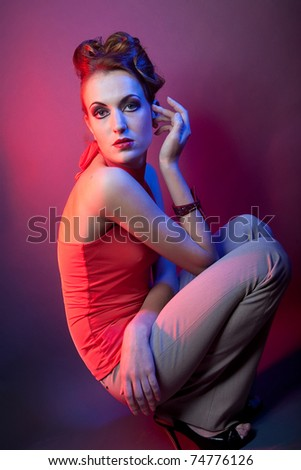 fashion model posing in studio - stock photo