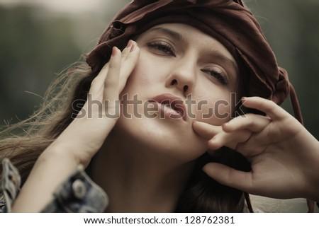 Fashion model posing in summer park - stock photo