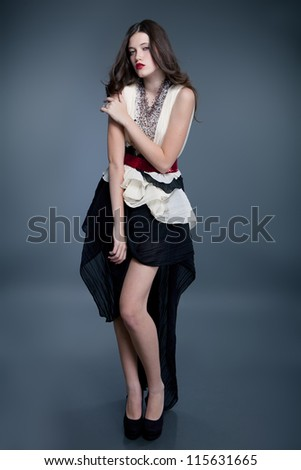 fashion model posing on gray background