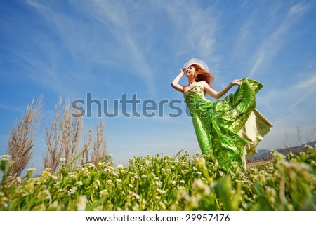 Fashion model posing on meadow - stock photo