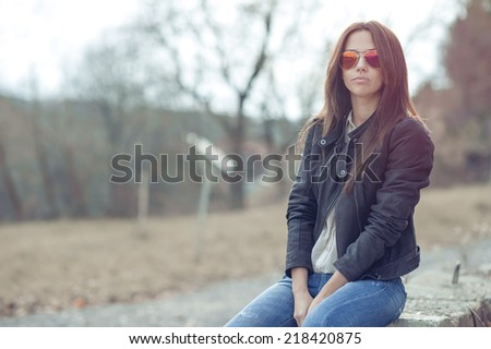 Fashion model posing outdoor wearing sunglasses