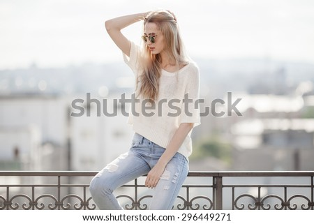 Fashion model. Summer look. Jeans, sweater, sunglasses. - stock photo
