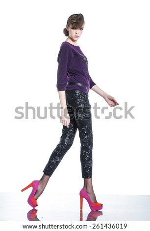 Fashion model. Walking in studio