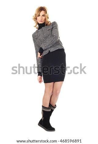 Fashion model wearing black sweater dress
