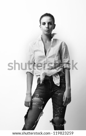 fashion model wearing blue jeans and white shirt