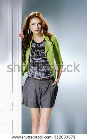 fashion model wearing modern posing in studio - stock photo