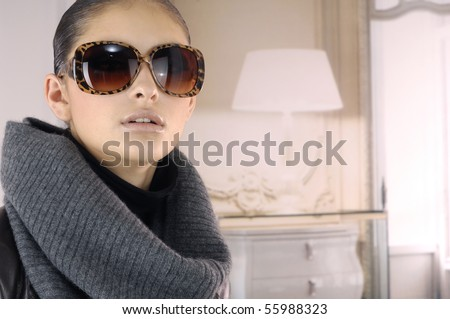 Fashion model wearing modern sunglasses, studio shot - stock photo