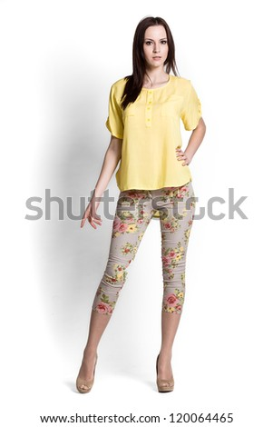 Fashion model wearing yellow blouse with emotions - stock photo