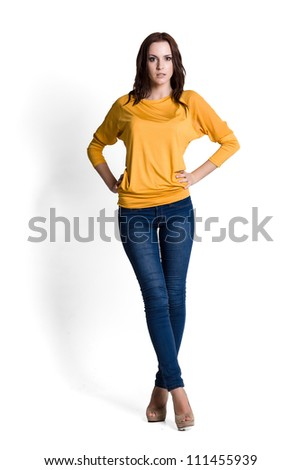 Fashion model wearing yellow sweater with emotions - stock photo