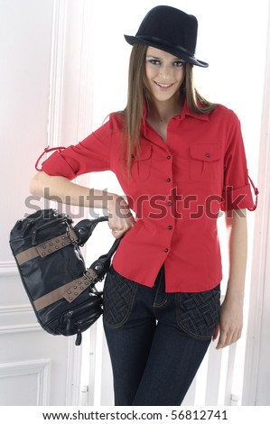 fashion model with bag posing in the studio - stock photo