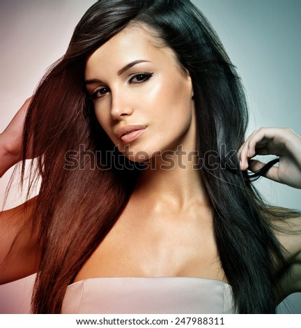 Fashion model with beauty long straight hair. Creative studio image.
