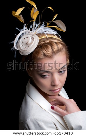 Fashion model with bridal hairstyle, isolated on black - stock photo