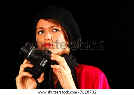 fashion model with camera looking for a shot - stock photo