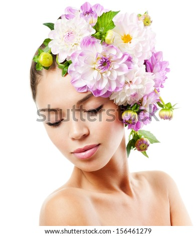 fashion model with   flowers in her hair. - stock photo