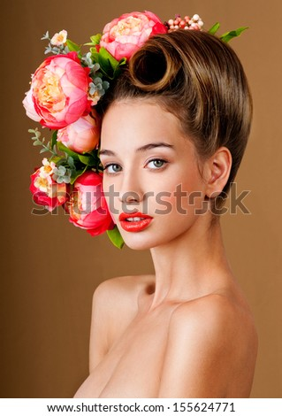 fashion model with hairstyle and flowers in her hair. - stock photo