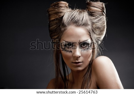 Fashion model with halloween makeup and hairstyle on black studio background - stock photo