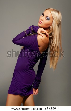 Fashion model with long blond hair - stock photo