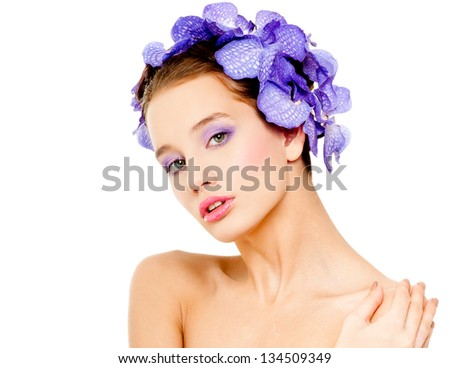 fashion model with  orchid  flowers in her hair. - stock photo