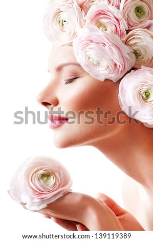 fashion model with  pink flowers in her hair. - stock photo