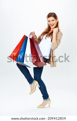 Fashion model with shopping bags. Isolated white background full length portrait. Young woman smile. - stock photo