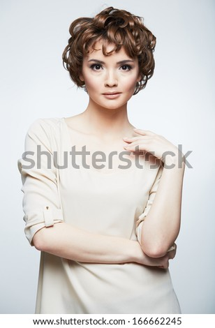 Fashion model with short hair . young woman portrait .