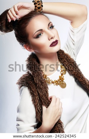 Fashion model with tousled hair, make-up, manicure. Portrait of young fashion woman with hairstyle, evening make-up, french nail polish  - stock photo