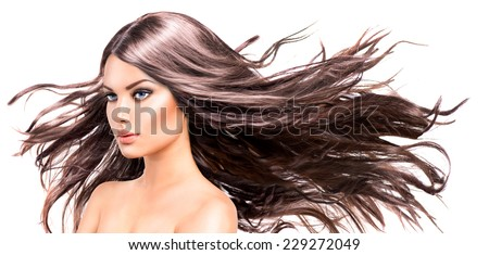 Fashion Model Woman Portrait with Long Blowing Hair. Glamour Beautiful Girl with Healthy and Beauty Brown Hair isolated on white background. Skin care and beautiful hair concept