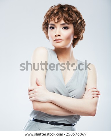 Fashion model woman posing in studio. Young model with short hair. Portrait of young beautiful woman.