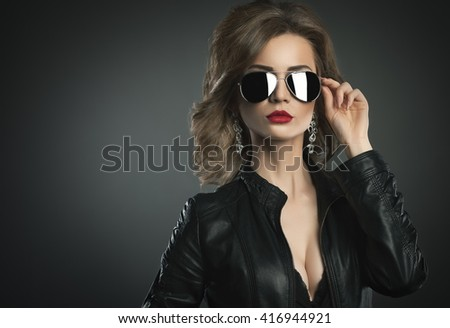 Fashion model young woman a pose in sunglasses. - stock photo